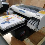 Best Stable performance A2 size WER-D4880T t shirt printing machine for all kinds of garments in Germany